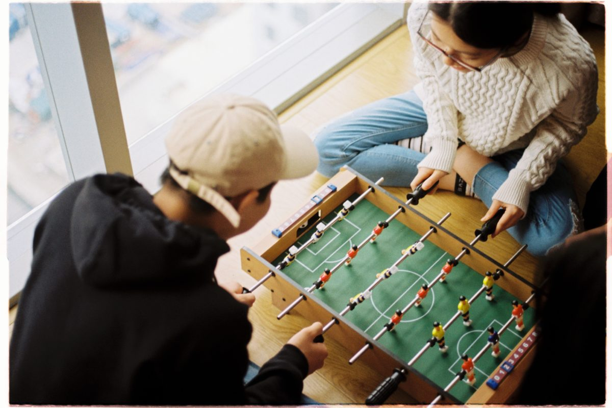 two peaople playing table football