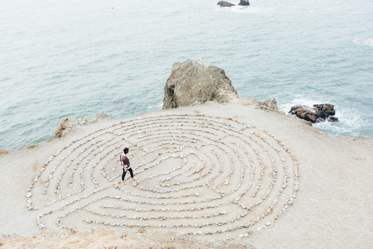 Person in labyrinth on beach